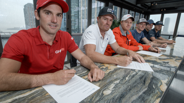 The helms from the six national SailGP Teams sign the UN Climate Change Sports for Climate Action fr